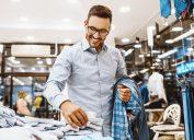 30-something white man in glasses shopping for clothing