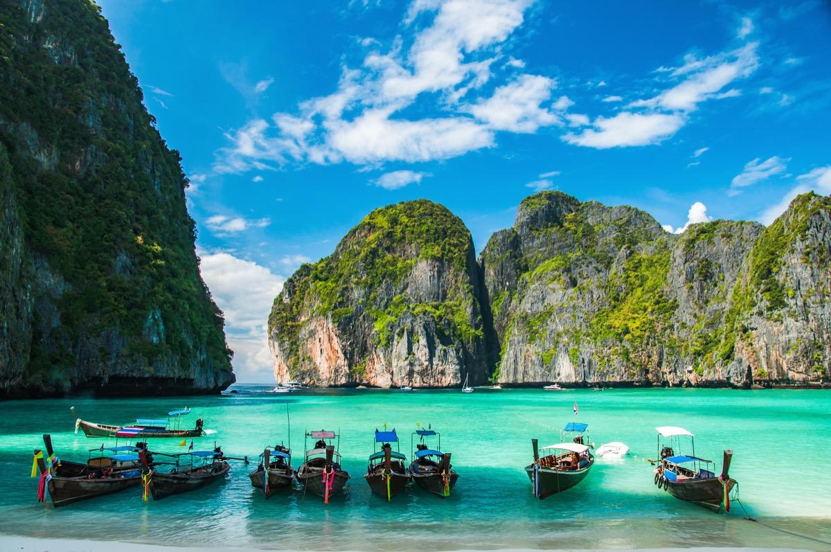 maya beach with canoe boats docked on the famous ko phi phi island