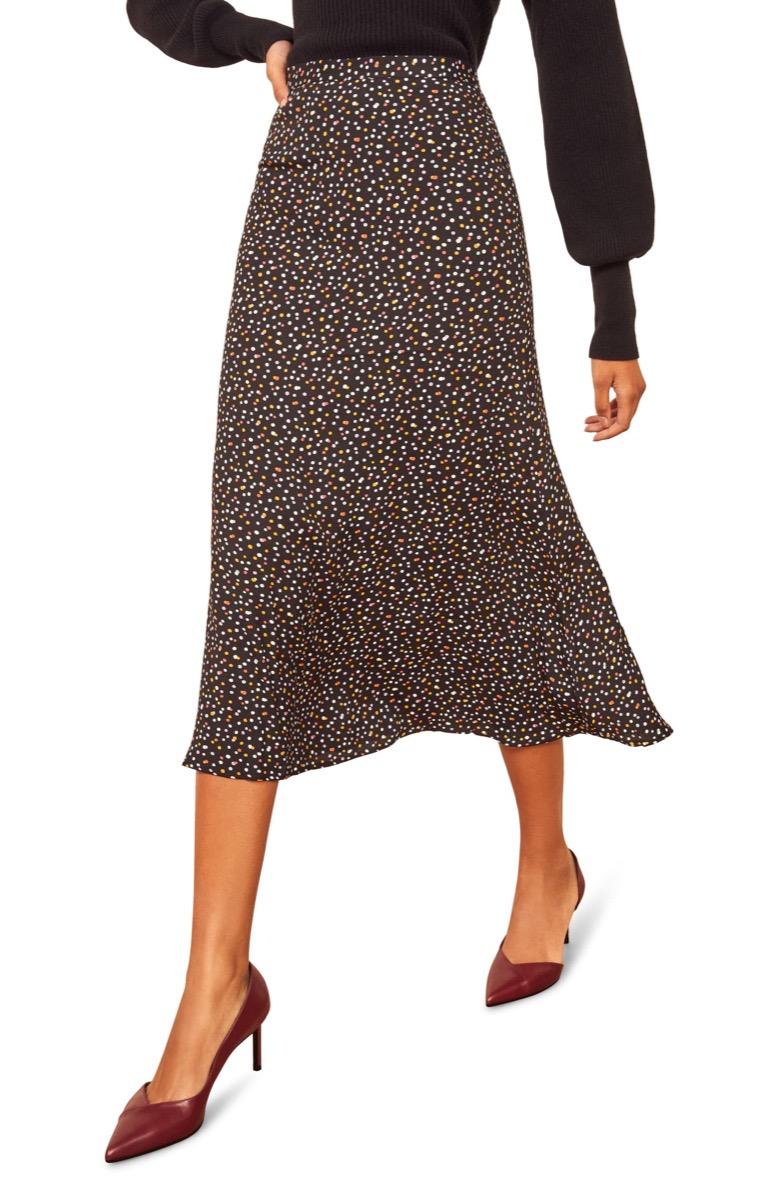 woman in midi skirt