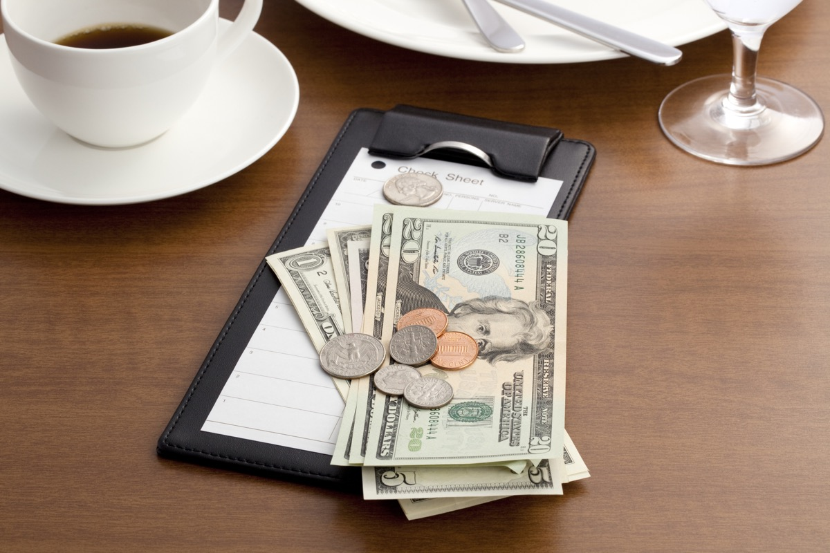 Guest check with Cash and Coin on white background