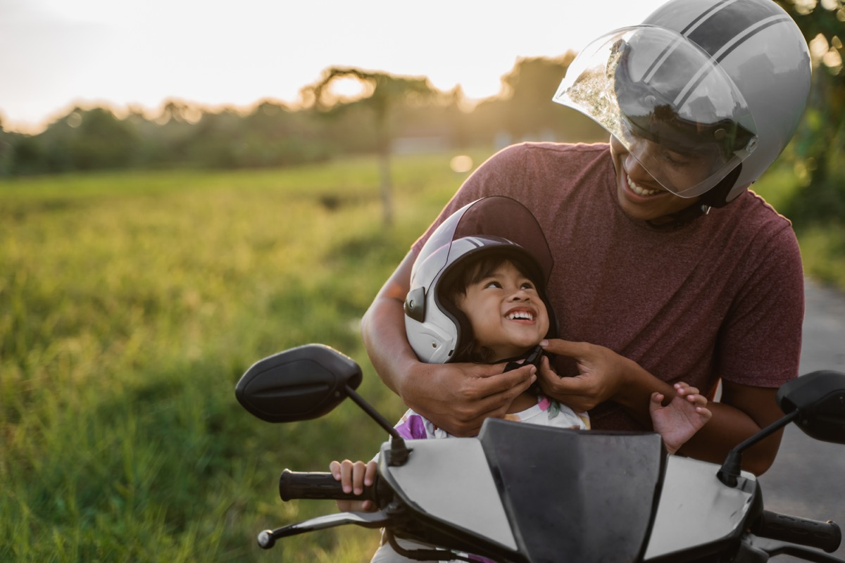 Father daughter on motorcycle