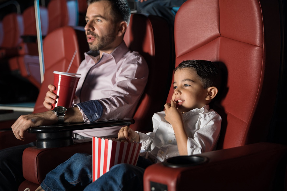 Father and son at the movie theatre