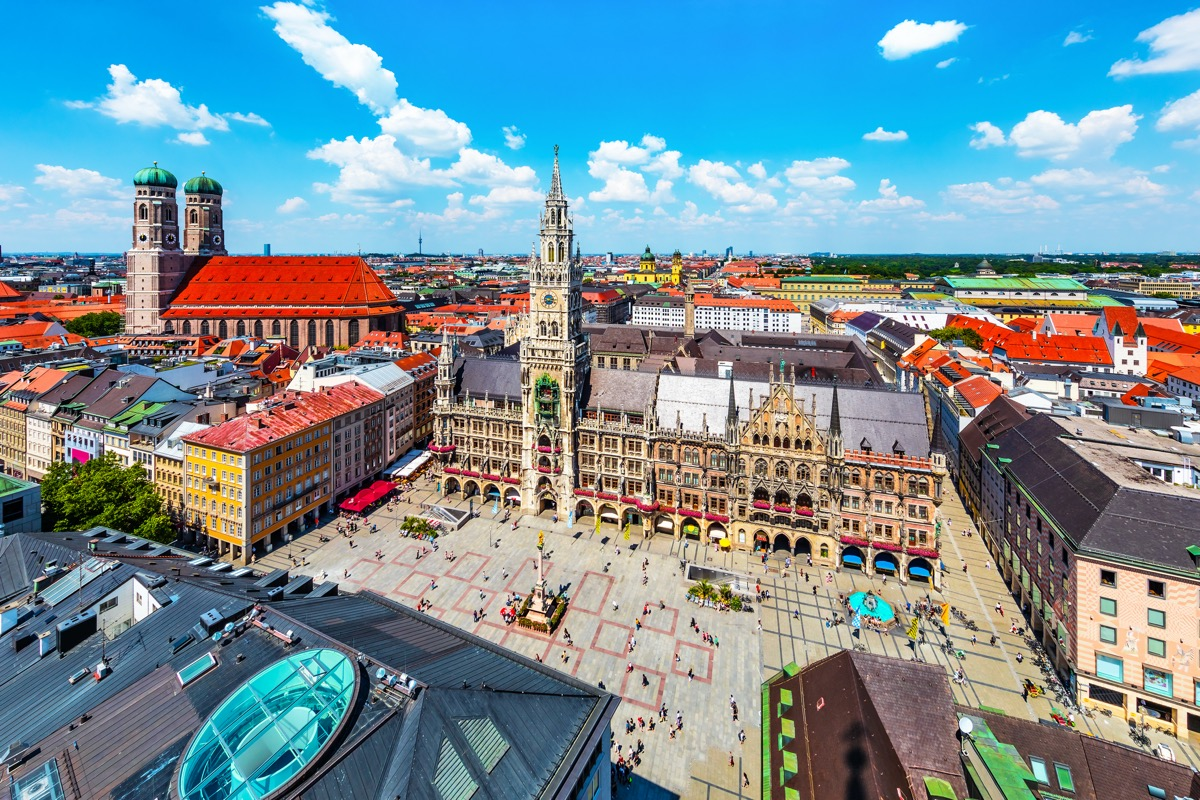 Scenic summer aerial view of the ancient medieval gothic architecture City Hall building at the Marienplatz Market Square in Munich, Bavaria, Germany.