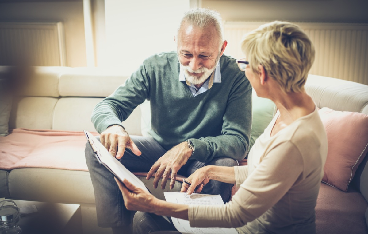 older white couple discussing paperwork