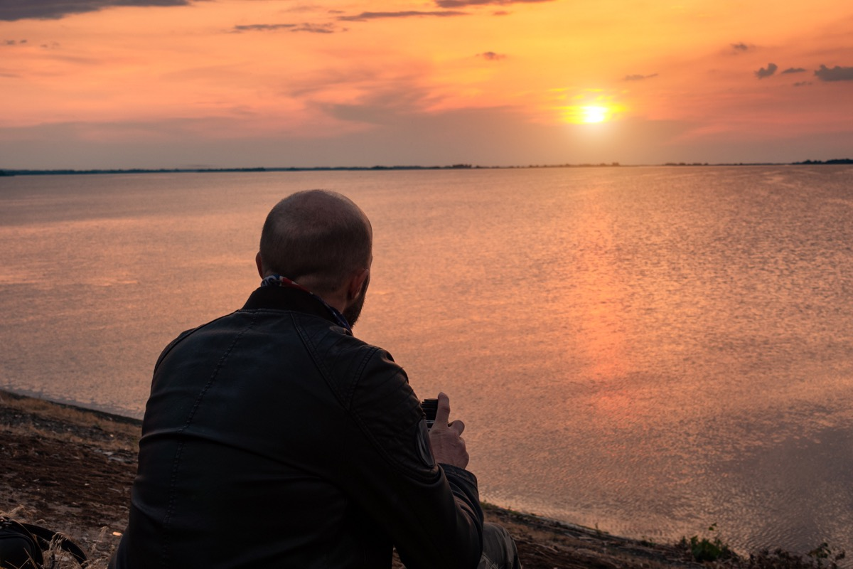 older man looking into sunset