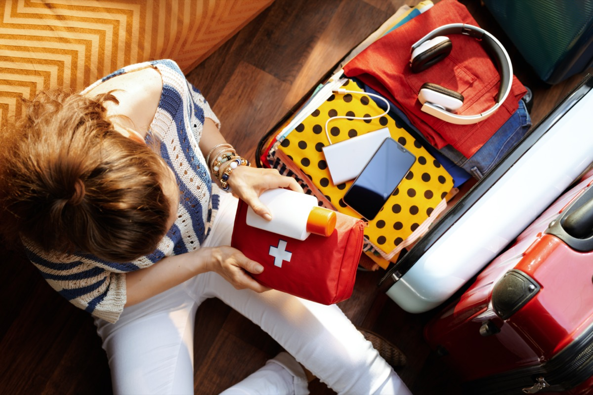 girl packing her first aid kit