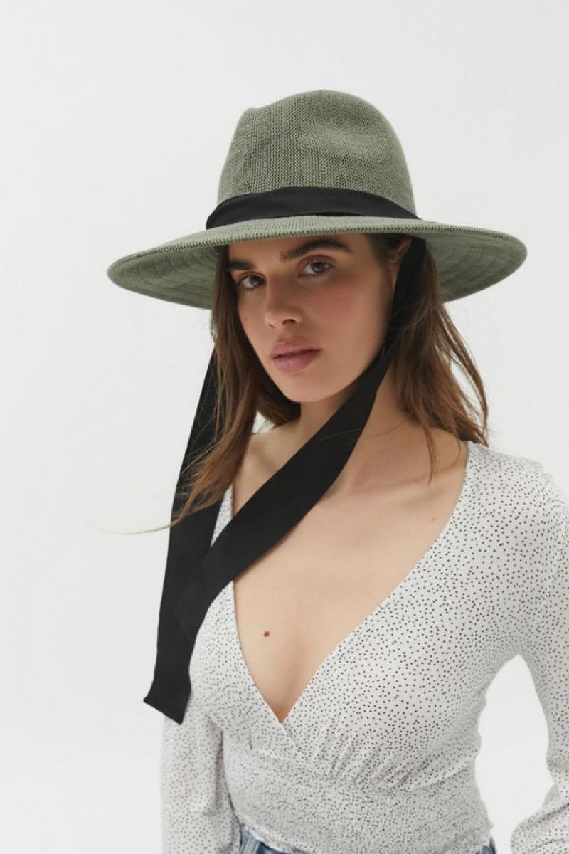 white woman in green panama hat