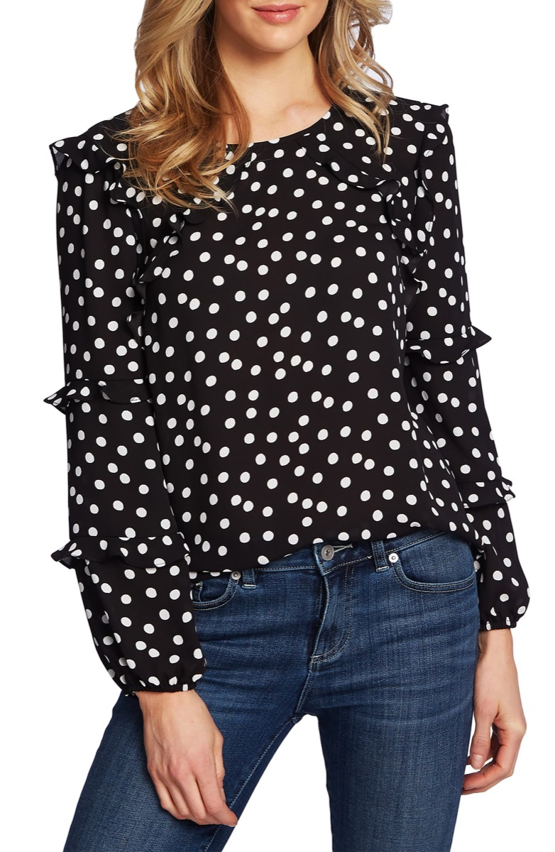 woman in black and white polka dot top