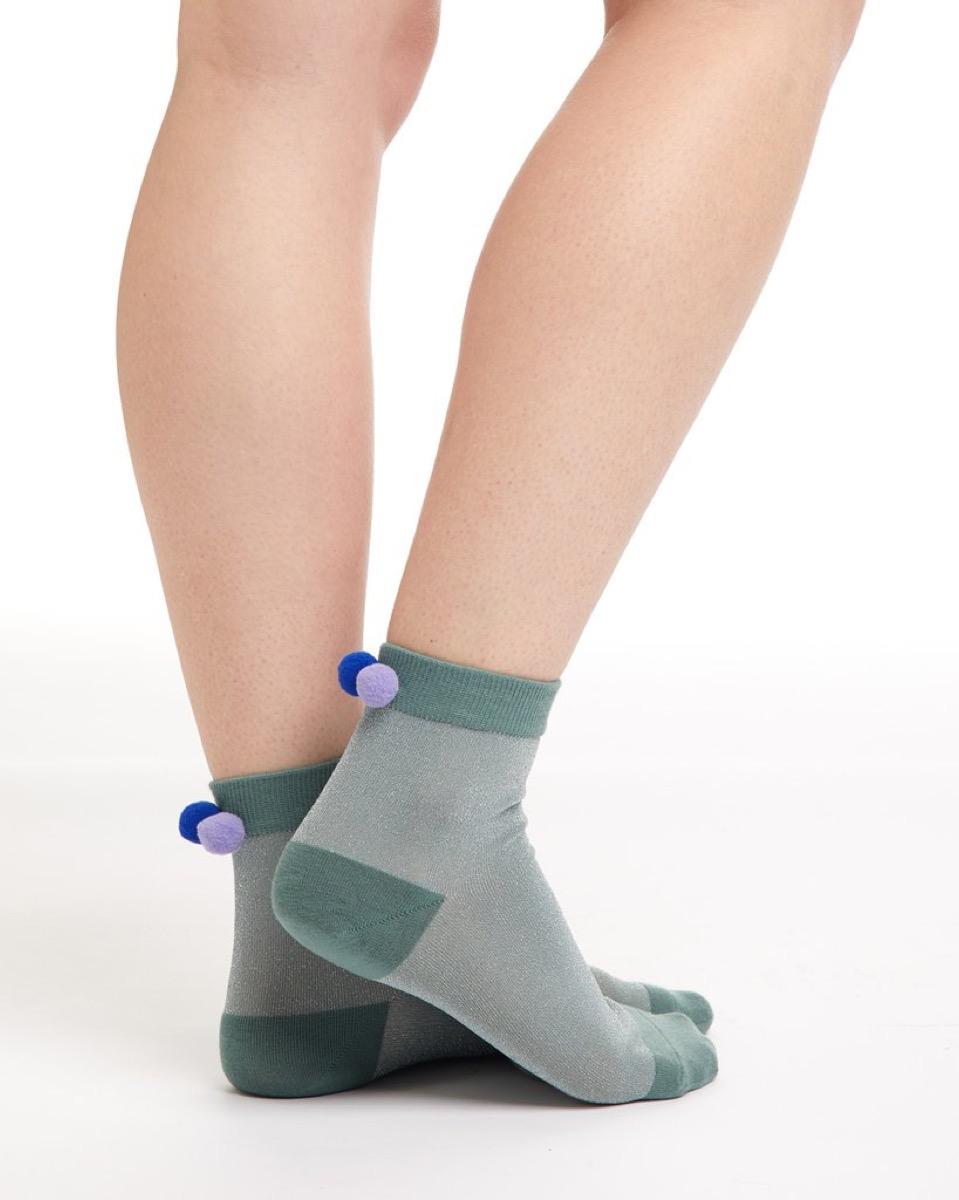 green pom pom socks