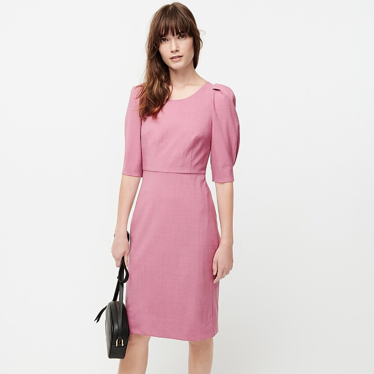 woman in pink puff sleeve dress