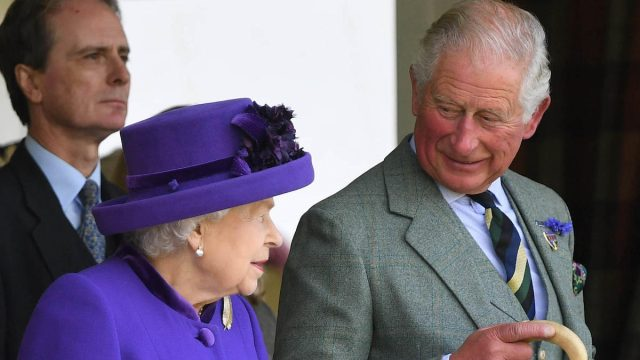 Queen Elizabeth II attends The Braemar Gathering with Prince Charles, The Prince of Wales, in 2019