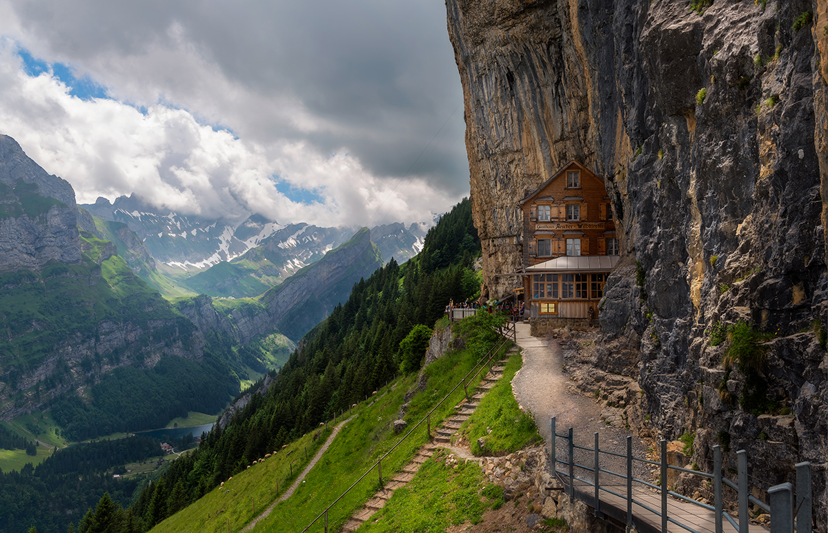 lodge built into the side of a mountain in switzerland