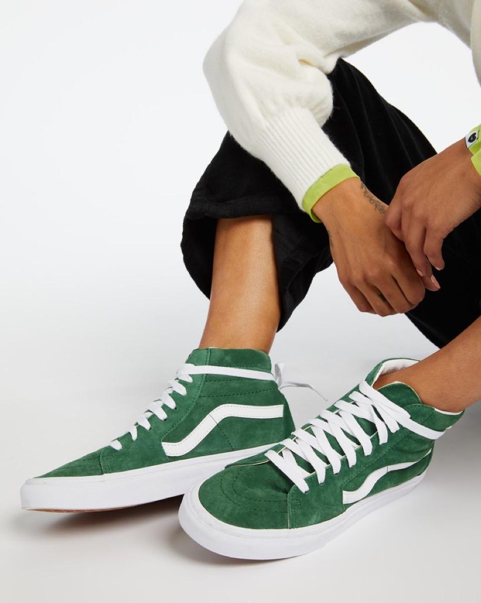 woman in green vans sneakers