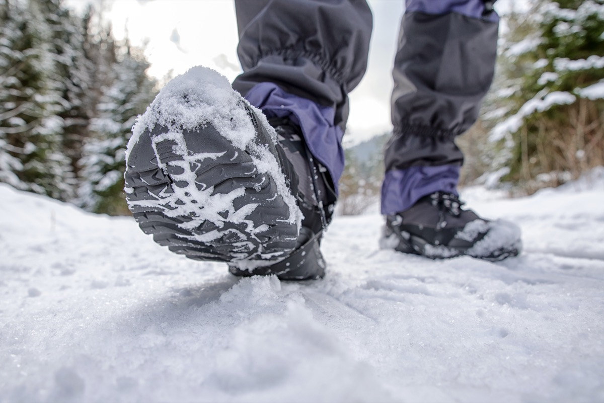 black hiking boots walking outside in the snow