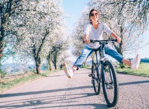 Woman biking during spring happy