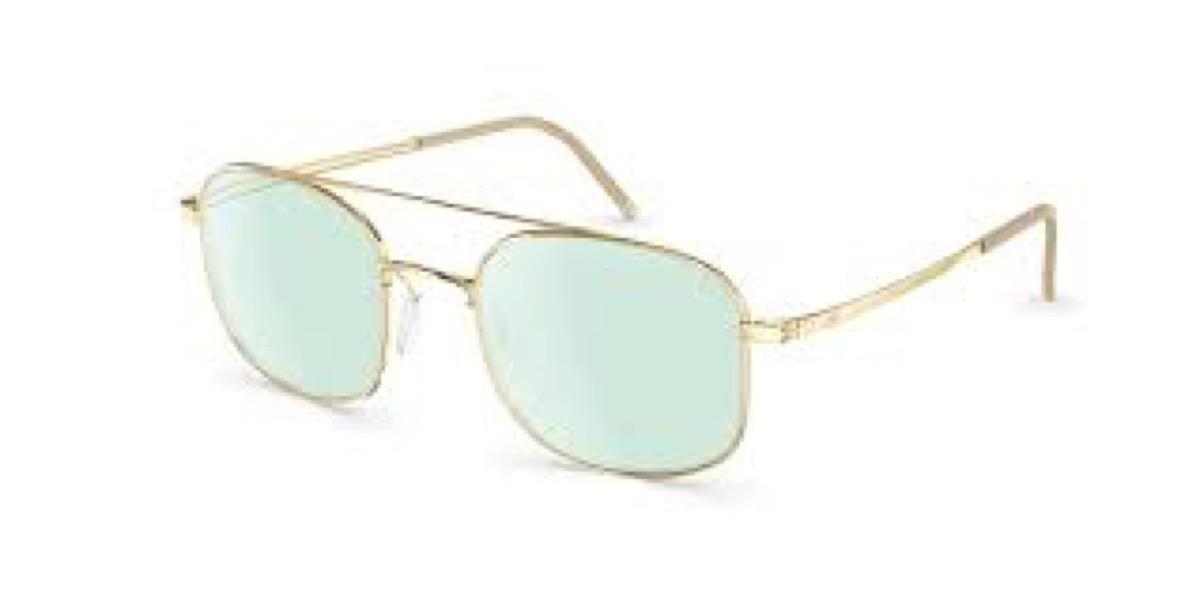 gold rimmed glasses with green lenses
