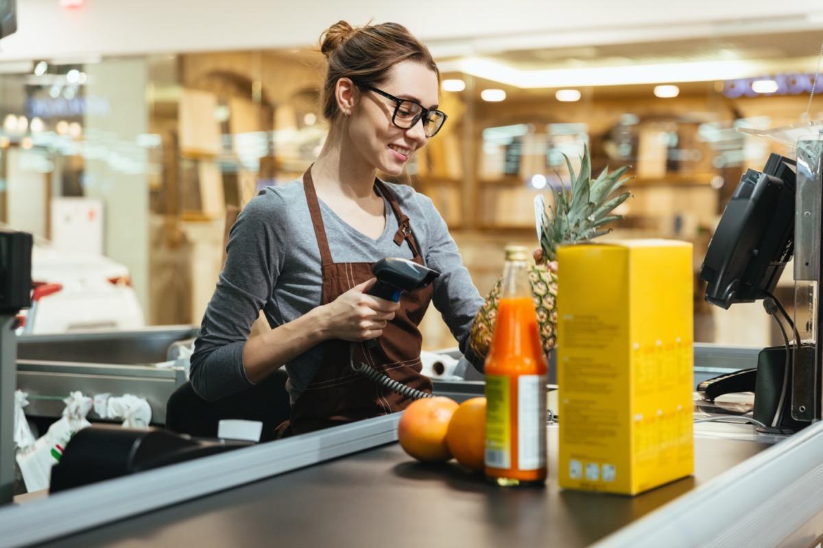 supermarket cashier scanning items