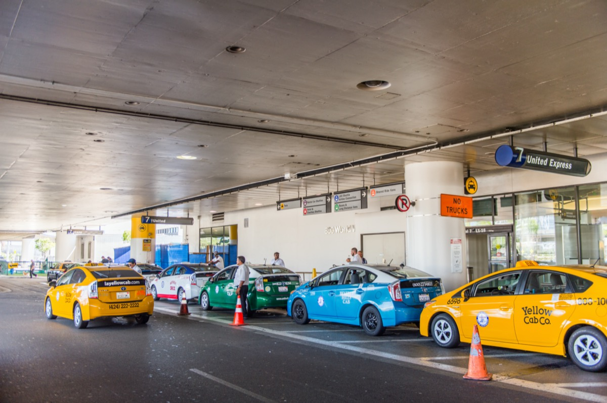 taxi lined up in front of airport