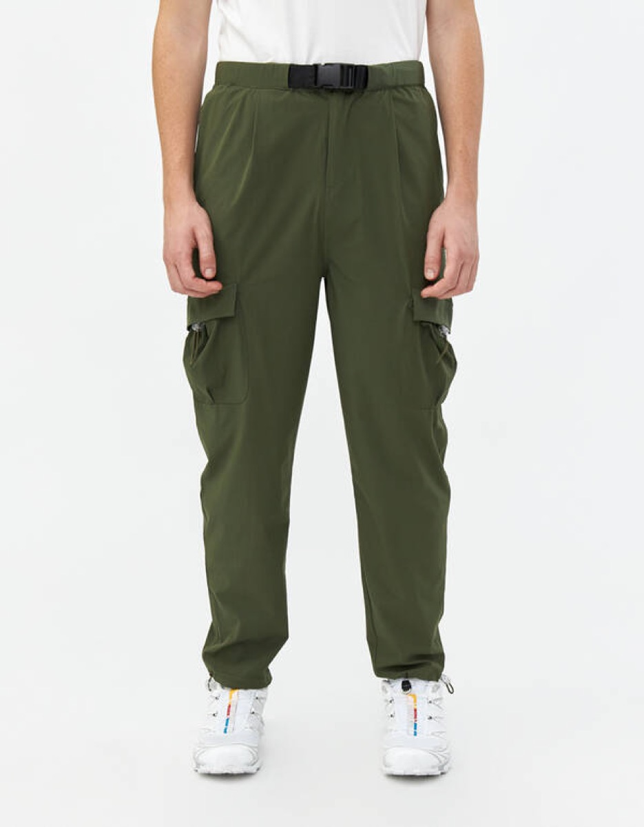 white man in green pants