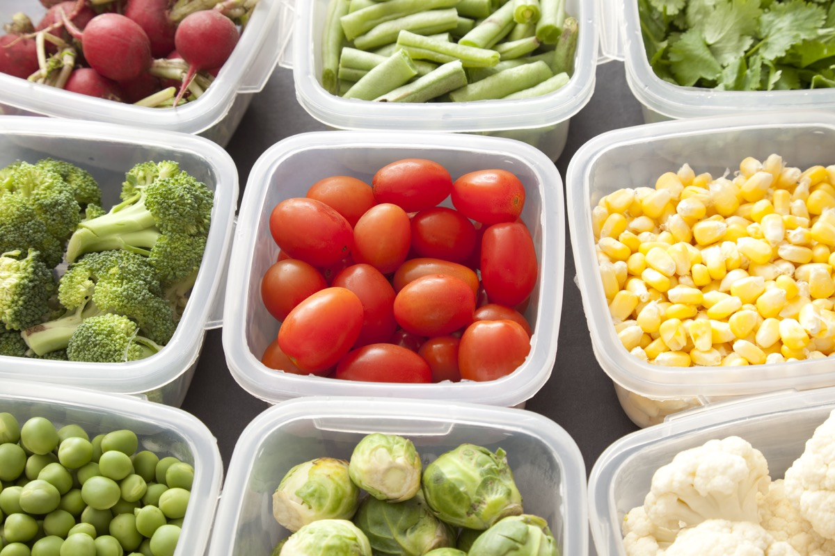different types of veggies each in a plastic container of tupperware