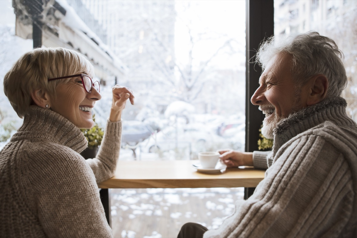 two older people in front of a mirror on a coffee date