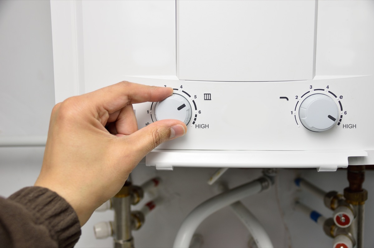 Person changing water heater