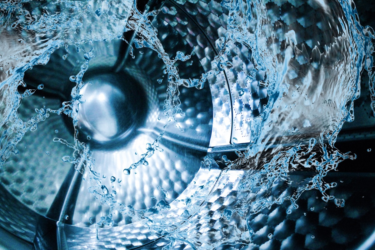 water swirling in close up of inside of washing machine