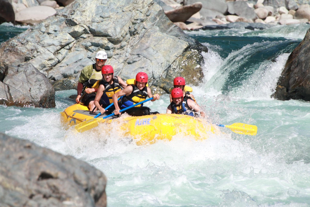 Family white-water rafting together