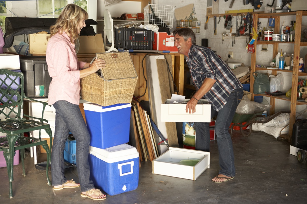 middle aged straight white couple cleaning garage
