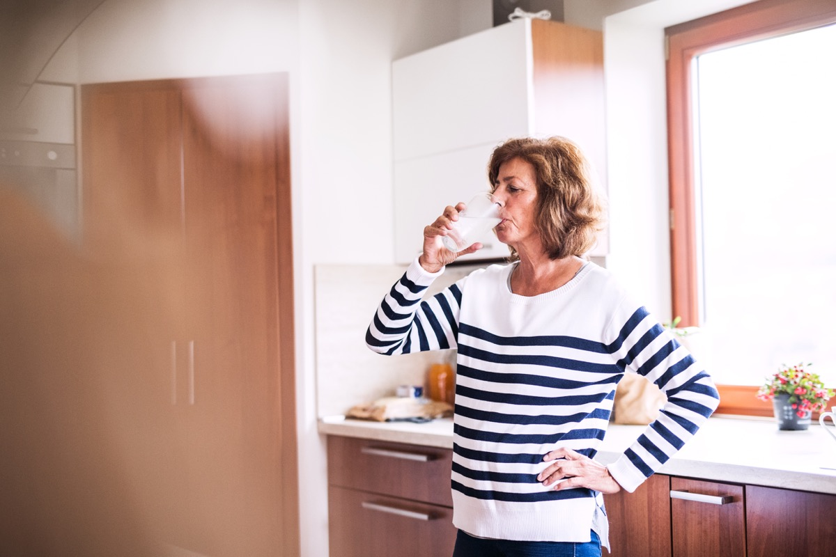 Older woman drinking water
