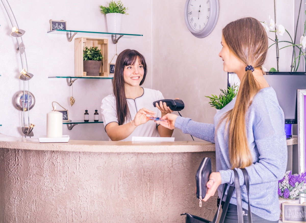 Woman paying for services at the salon