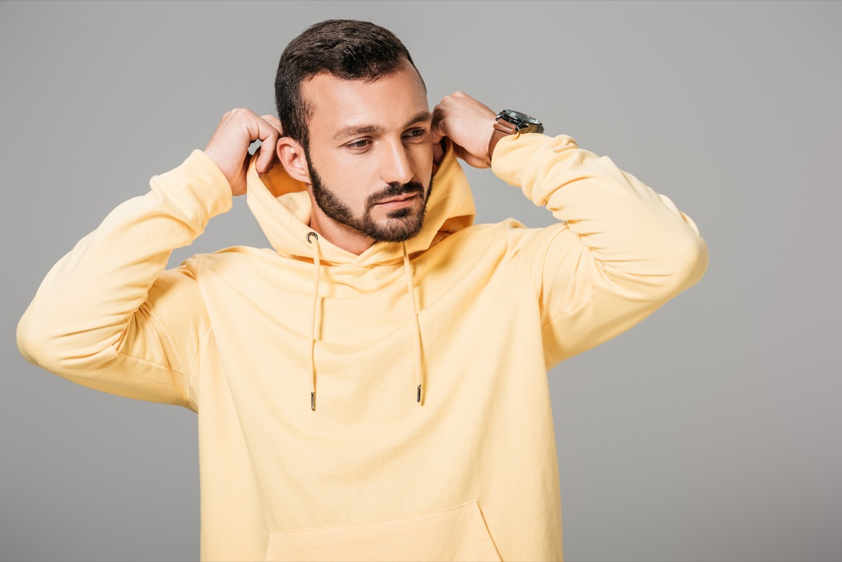 Man wearing a yellow hoodie