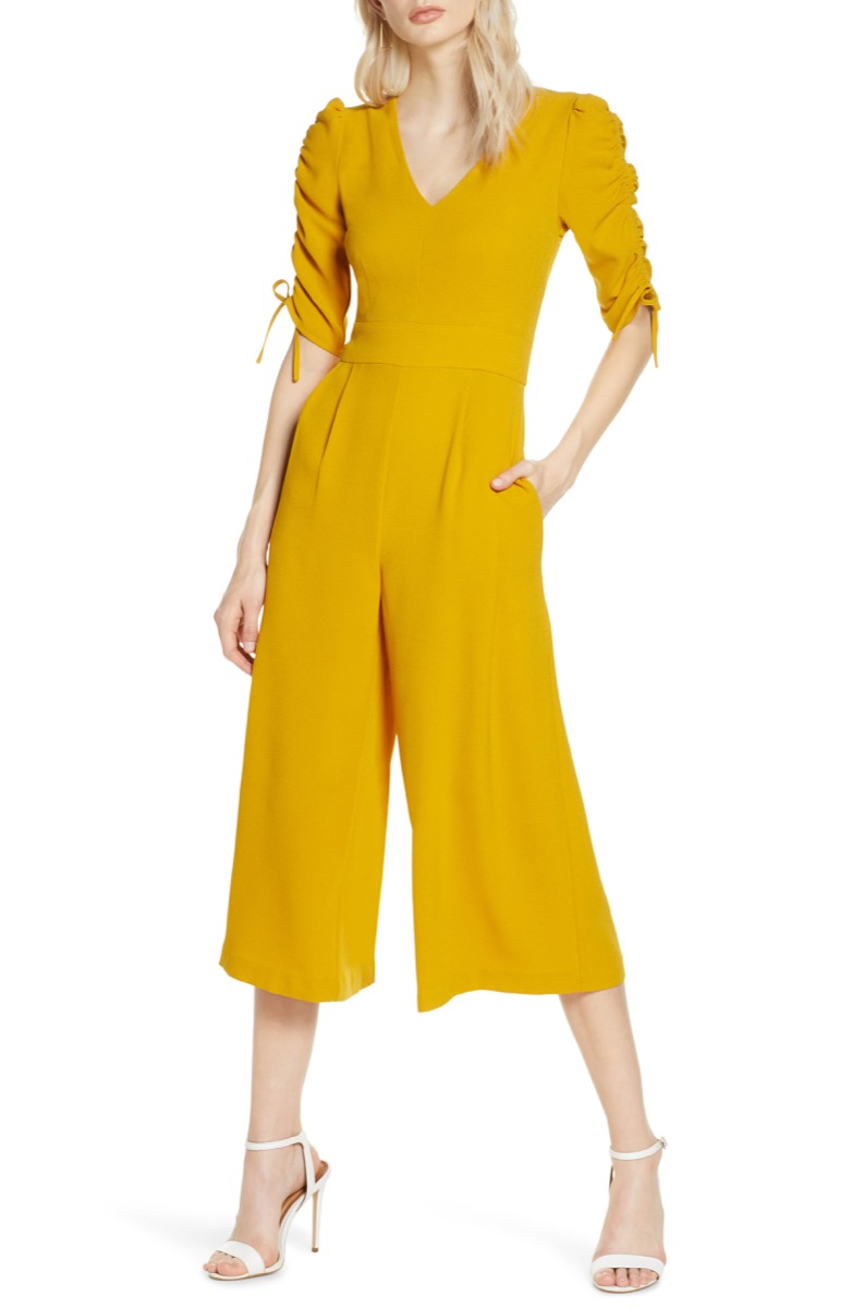 woman in yellow jumpsuit