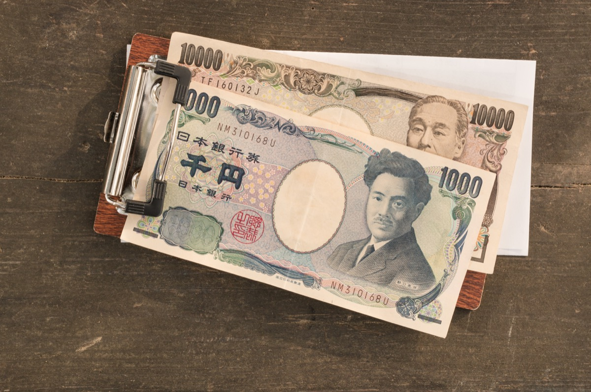 Yen Japanese money paying the bill in Japan