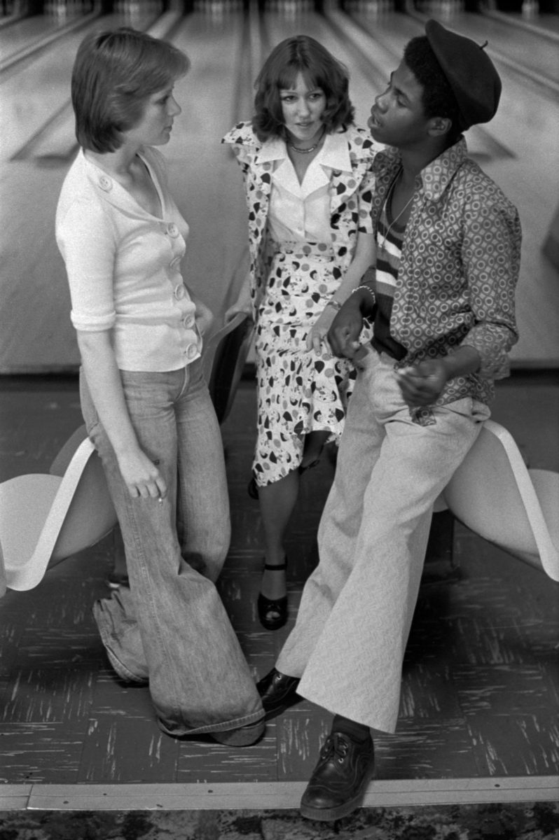 Teenagers hanging out at bowling alley in 1970s, wearing bellbottoms