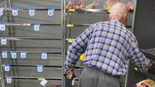 people helping elderly shopping