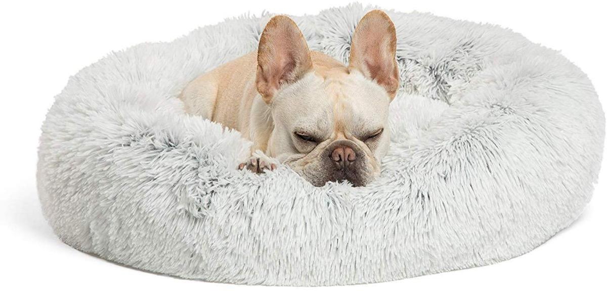 French bulldog sleeping on plush fur bed