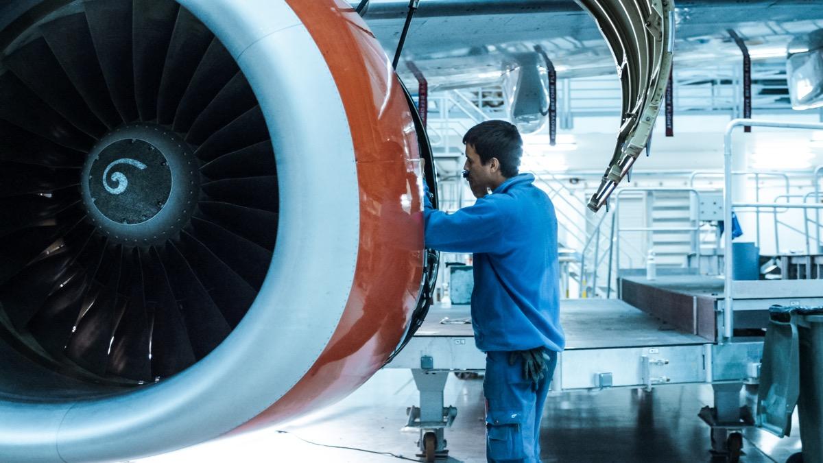 mechanic checking an airplane engine