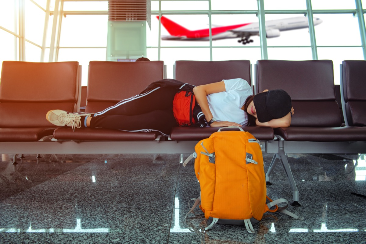 woman dressing like she just woke up, at the airport
