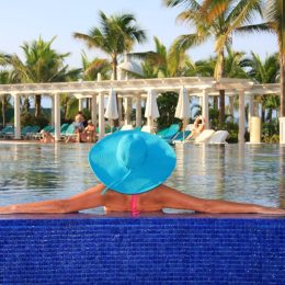 woman enjoying the pool at a resort