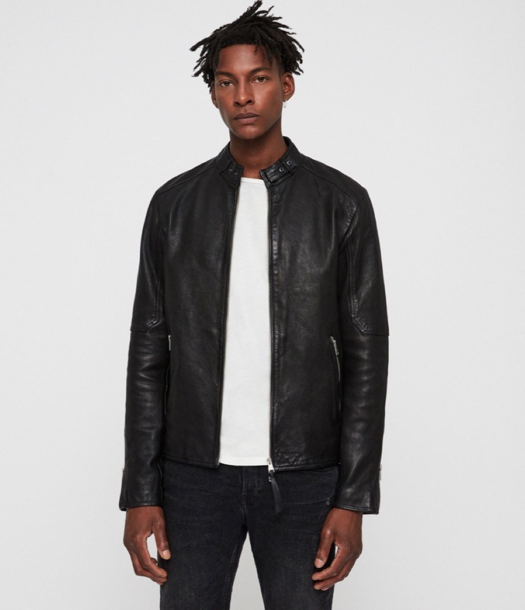 young black man in black leather jacket