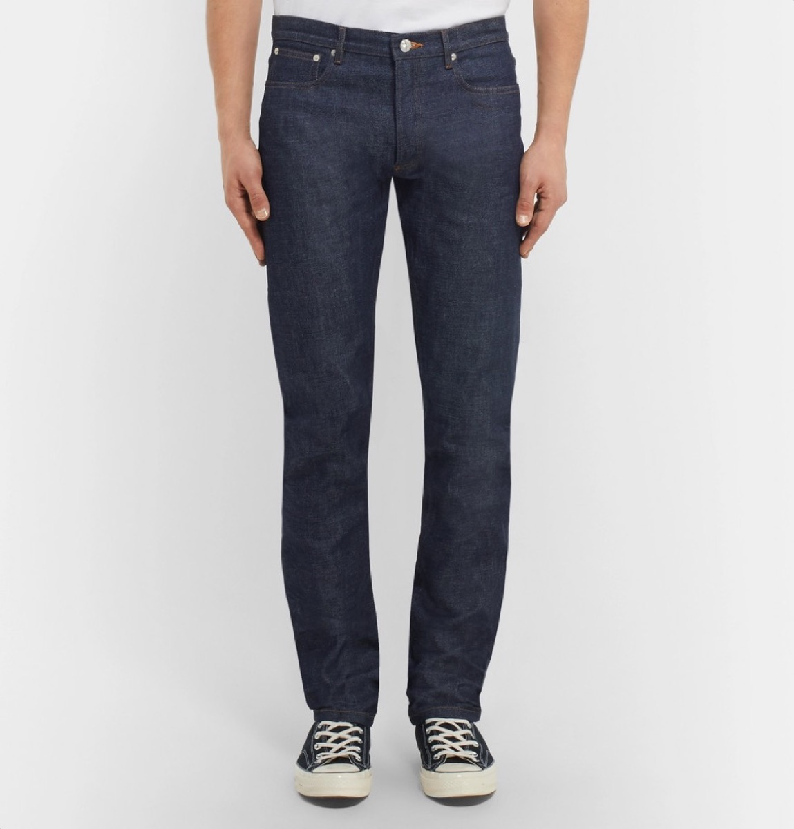 young man in dark blue jeans