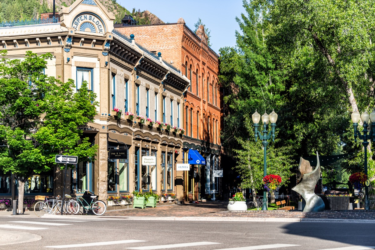 Town in Colorado with vintage architecture on street park square in luxury expensive famous city during summer day