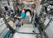 NASA astronaut Anne McClain works inside the Japanese Kibo laboratory aboard the International Space Station January 30, 2019 in Earth Orbit