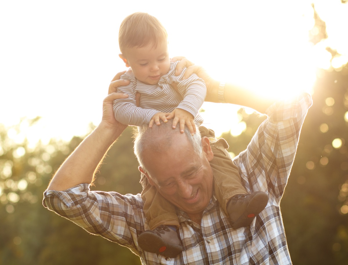 Grandfather with grandson on shoulders
