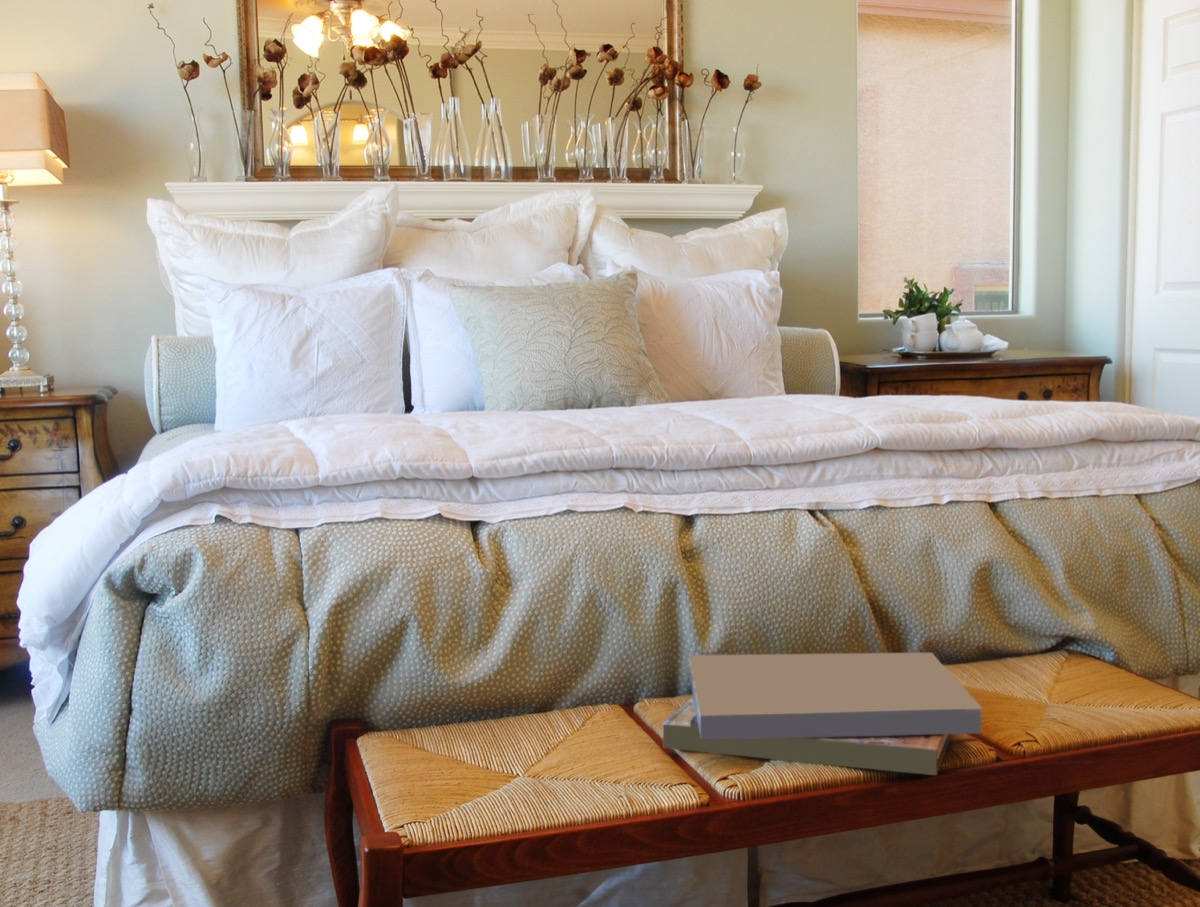 elegant bed with throw pillows