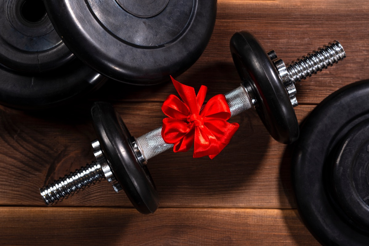 black dumbbell with red bow