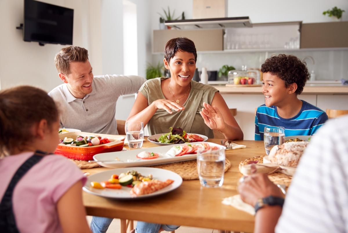 Blended family having dinner