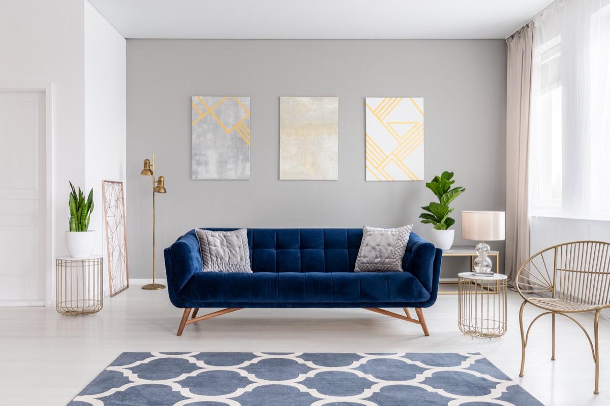 blue velvet chair in modern living room