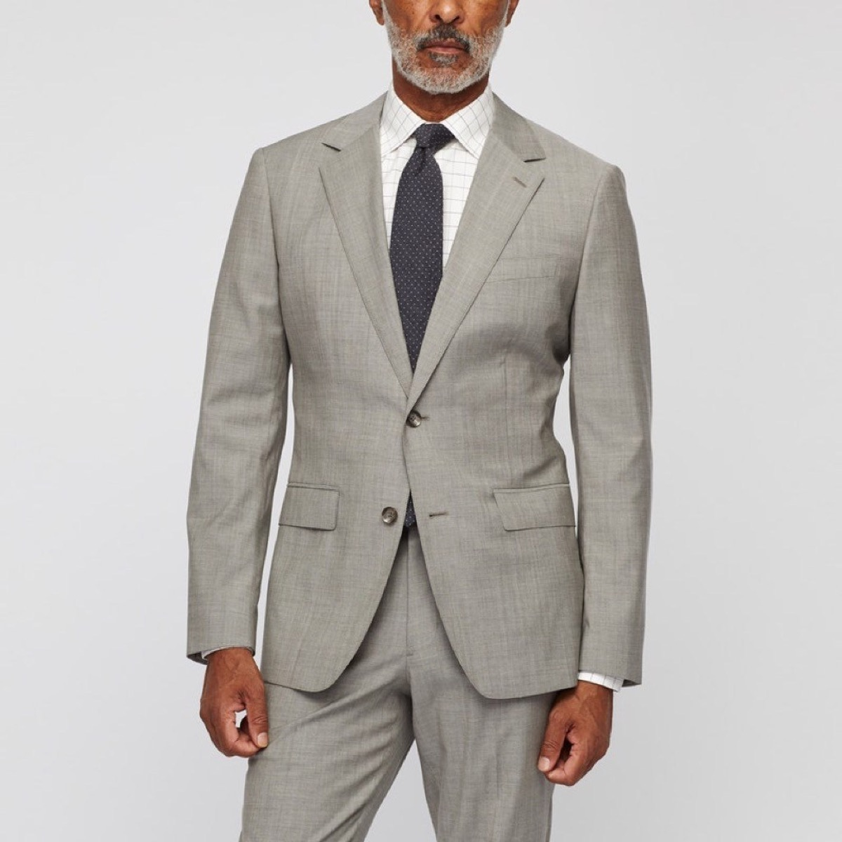 middle aged black man in gray suit